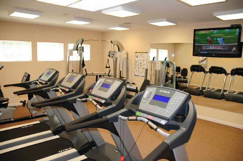 North Brunswick Manor Gym photo showing four treadmills, an exercise bike and various other exercise equipment.