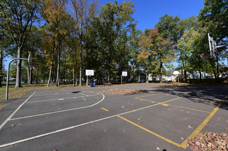 Photo of several nearby outdoor basketball courts