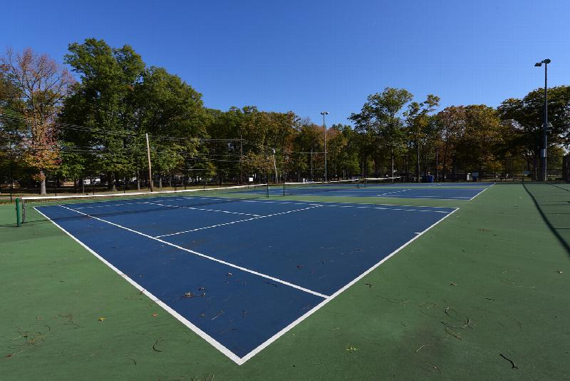 Photo of several nearby outdoor tennis courts