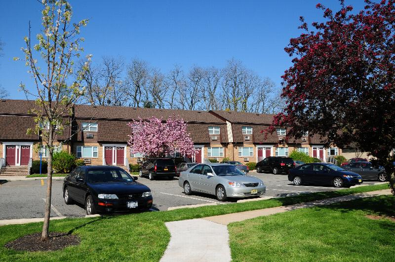Woodbridge Village exterior image shows an apartment building in the
